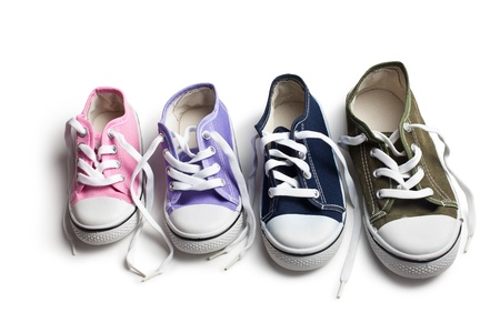 various sneakers on white background photo