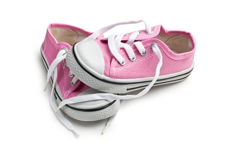 pink baby sneakers on white background photo