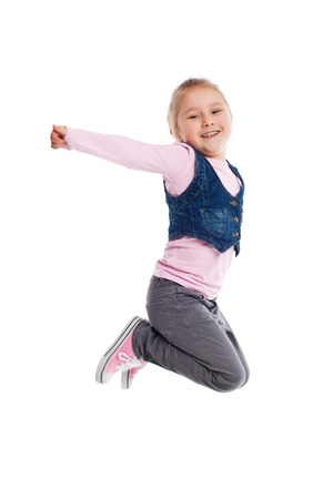 the happy little girl jumping in air photo