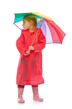 rain boots: Little girl with umbrella. Studio shot.  Stock Photo