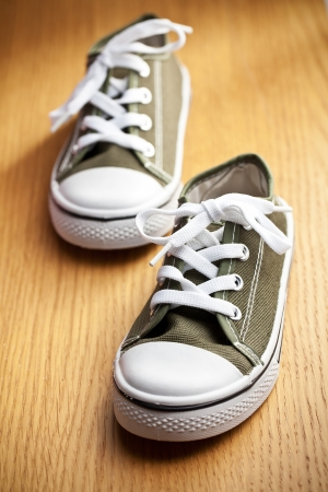 the colorful sneakers on wooden floor Stock Photo - 17308309