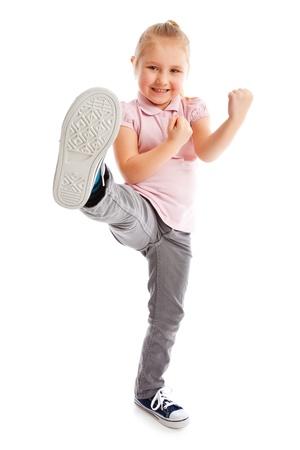 Little girl kick by foot. Studio shot.