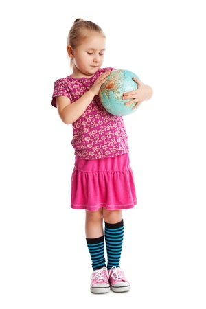 Little girl holding a globe  Studio shot  photo