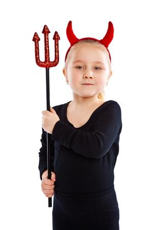 devil horns: Little girl in devil costume. Studio shot.