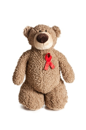 the teddy bear with red ribbon aids awareness  Stock Photo - 17389339
