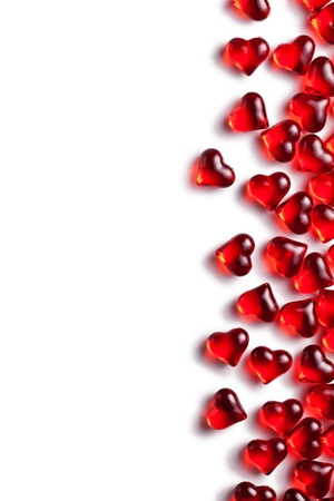 the red glass hearts on white background photo