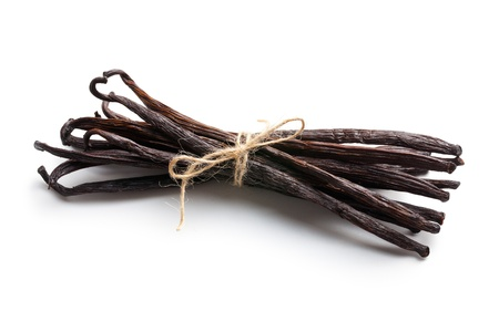 tied vanilla pods on white background
