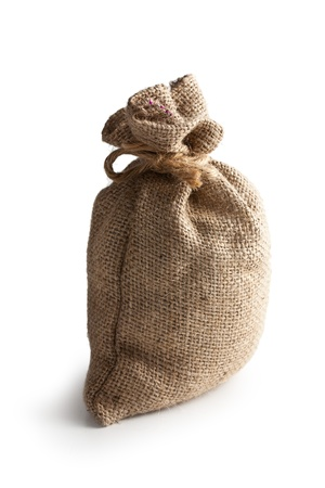 sea salt in jute sack on white background photo