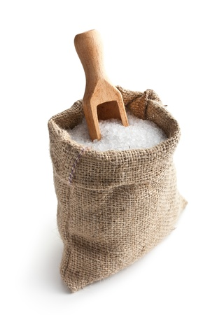 scoops: sea salt in jute sack on white background