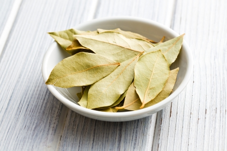 the bay leaves in white ceramic bowl Stock Photo