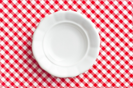 the white old plate on checkered napkin Stock Photo - 18005418