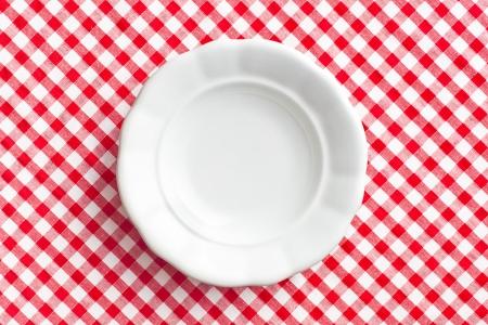 the white old plate on checkered napkin Stock Photo - 18005418