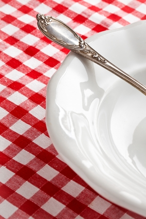the detail of vintage cutlery on white plate photo