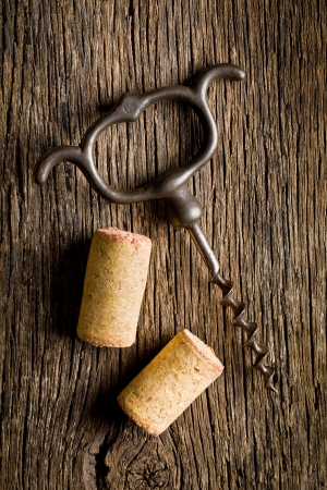 opener: wine cork and corkscrew on wooden table Stock Photo