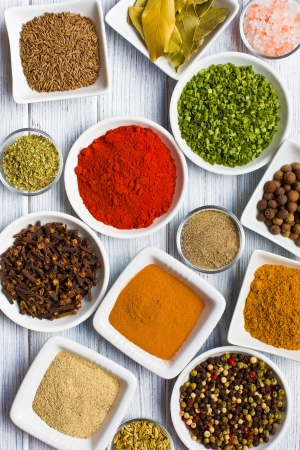 Various spices and herbs on wooden table. photo
