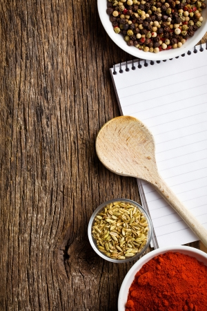 food additives: blank notebook and spices on wooden table Stock Photo
