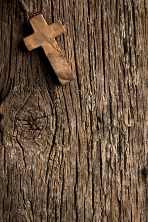 the antigue wooden cross on old wooden background photo
