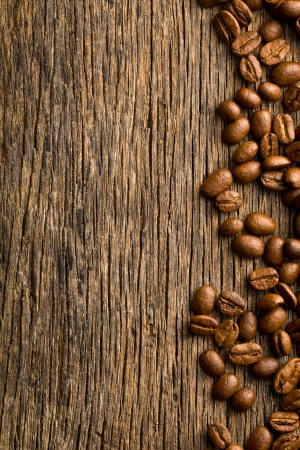 the coffee beans on vintage wooden background photo