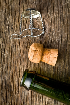 bootle: champagne cork and bootle on old wooden table