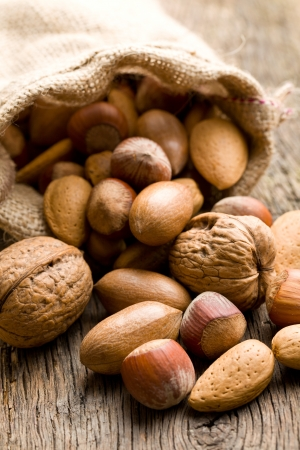 the various nuts in jute sack photo