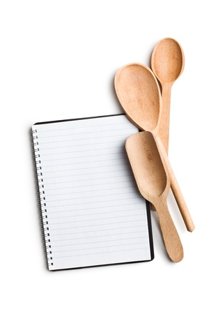 blank recipe book with kitchen utensils on white background photo