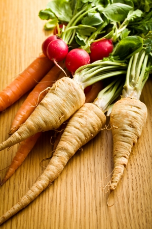root vegetables on wooden table photo