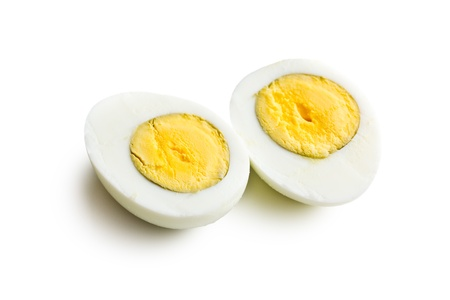 yolk: two halves of a boiled egg on white background