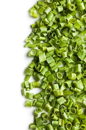 slicing: green chives on white background Stock Photo