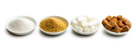 granulated: various types of sugar in ceramic bowls