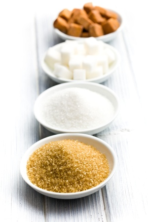 various types of sugar in ceramic bowls photo
