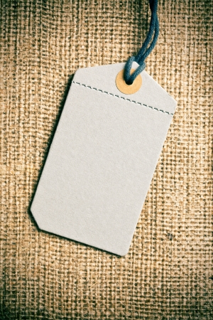 the blank price tag label on burlap background  photo
