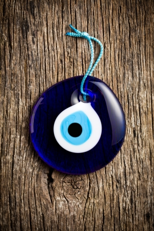 magic eye: glass turkish eye on wooden background Stock Photo