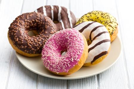 doughnut: various donuts on kitchen table