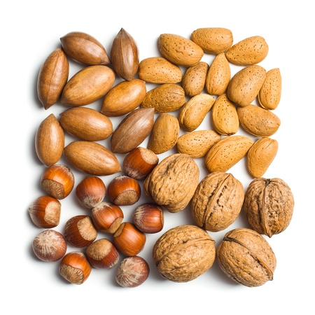 unpeeled: various unpeeled nuts on white background Stock Photo