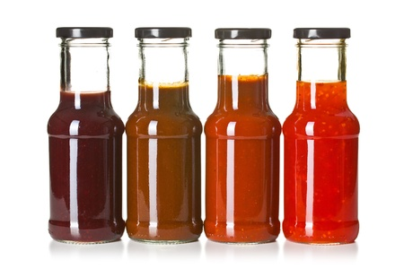 the various barbecue sauces in glass bottles photo