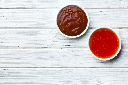 bbq sauce: the various barbecue sauces in ceramic bowls