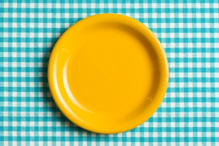 checker plate: the empty plate on checkered tablecloth Stock Photo