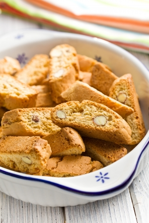 crumbly: cantuccini cookies in ceramic bowl on kitchen table