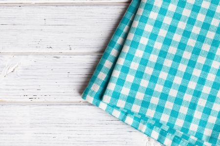 table linen: checkered napkin on wooden table