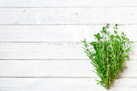 on herb: various herbs on kitchen table