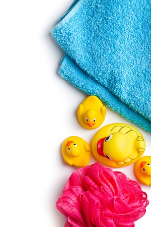 yellow bath ducks and bath puff on white background photo