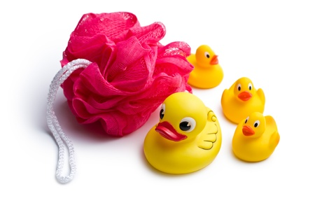 squeak: yellow bath ducks and bath puff on white background
