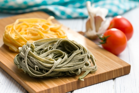 Italian pasta tagliatelle on kitchen table photo