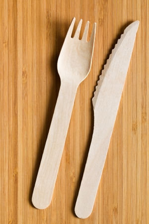 set of wooden cutlery on wooden table photo