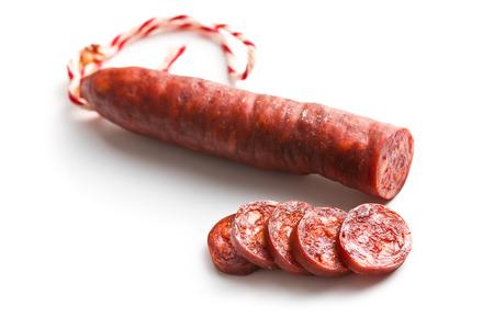 salame: sliced tasty chorizo sausage on white background Stock Photo