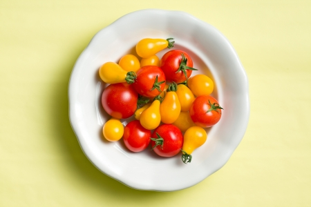 tomatos: top view of various tomatoes on plate Stock Photo