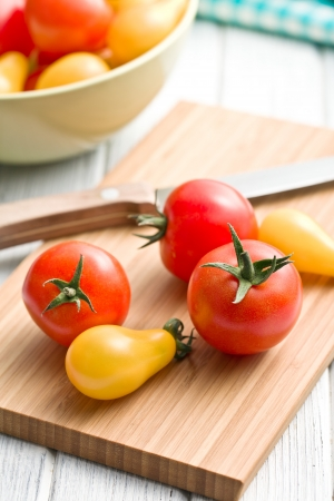 tomatos: various tomatoes on cutting board Stock Photo