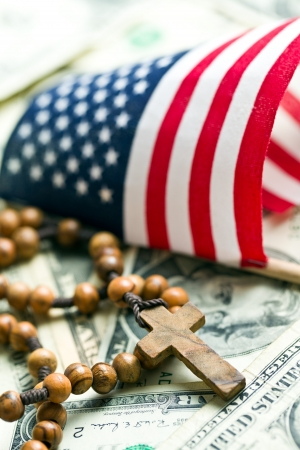 rosary beads with american flag on us dollars background photo