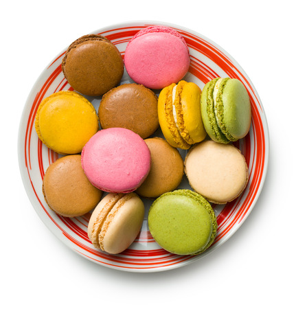 tasty colorful macaroons on plate  photo