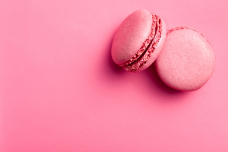 top view of tasty pink macaroons  photo